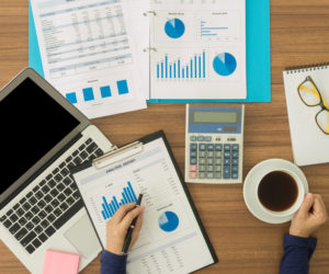 SEM Reporting - The Xcite Group-analyst looking at charts and graphs