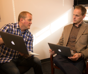 Search Engine Marketing-The Xcite Group Brian and Nick on their laptops