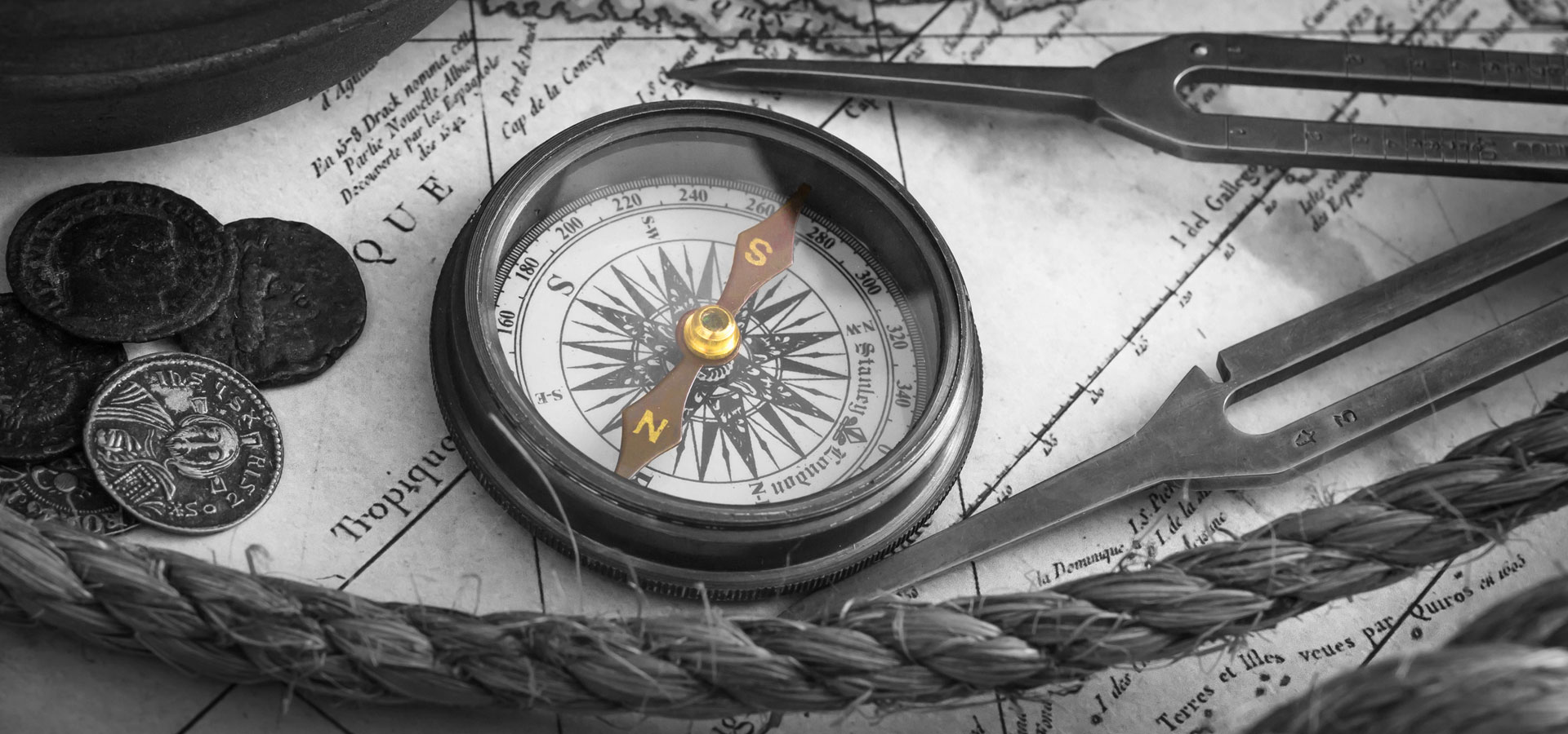 Stay Ahead - The Xcite Group-vintage compass and map
