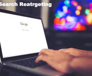 Search Retargeting - The Xcite Group-man using Google on his laptop