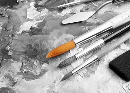The Xcite Group - Create & Engage black and white canvas with paintbrushes
