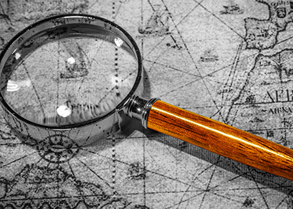 The Xcite Group - Get Results-magnifying glass with historical map