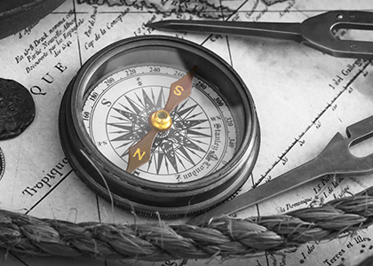 The Xcite Group - Stay Ahead-What We Do-black and white photo of vintage compass