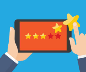 Hand pointing to a tablet with five star on the screen. Customer reviews, rating, classification concept Vector Illustration