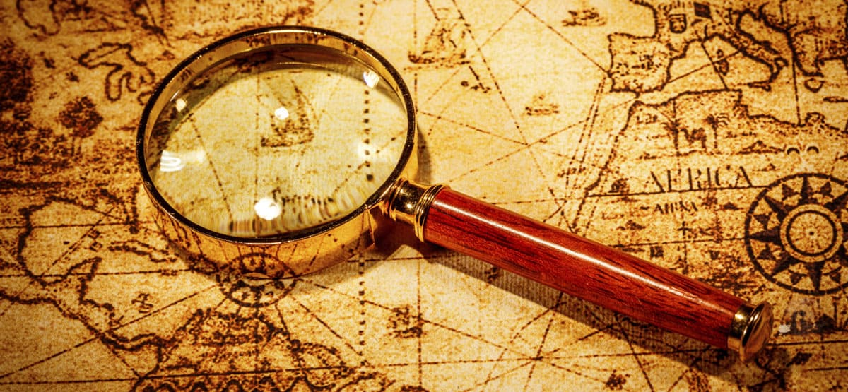 magnifying glass on old map